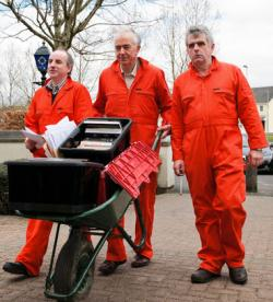 Edward Horgan, John Lannon and Niall Farrell present wheelbarrows of information about illegality at Shannon to the Gardai (March 2011)