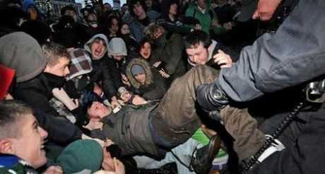 Gerry Carroll being dragged out of the crowd by officers