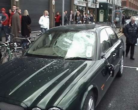 Smashed window of car in Nassau Street (before being set alight)