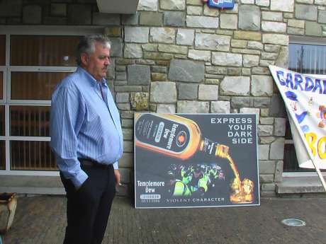 Head of IRMS, Jim Farrell infront of an appropriate sign