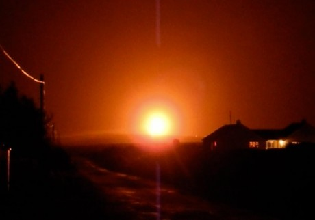 Courtesy MayoNews -LIKE THE SUN A still image taken from a recording shows the glow from the flaring at the Corrib Gas terminal on New Year's Eve.