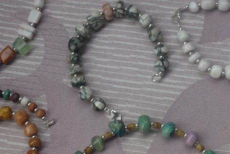 pretty rocks from nm, discovered and mined by me, cut and polished then designed by me into neo-celtic adornment