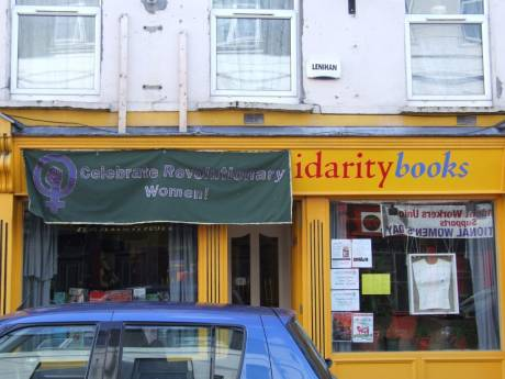 Banner on Solidarity Books, Douglas St., all day