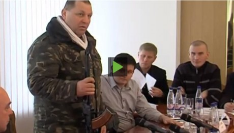 'I dare you to take my gun!' AK-47-toting Ukraine far-right leader Aleksandr Muzychko tells officials