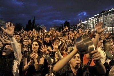 greek protesters trying out the indignant model of things instead of their usual angry stuff.