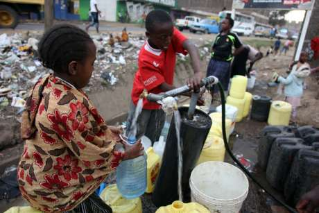 Children collecting water after the supply was re-instated.
