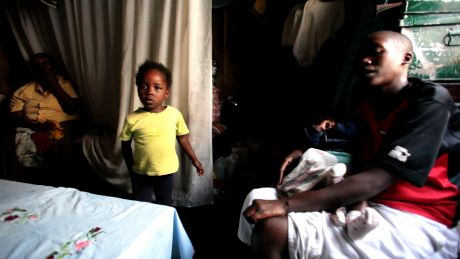 Pauline with her mum and two children in their one room home. They had been forced to flee their home during the post election violence of 2007. (video screengrab)