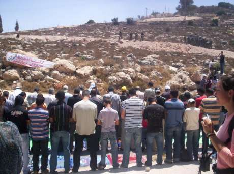 Palestininians pray before demonstration against the Annexation Wall