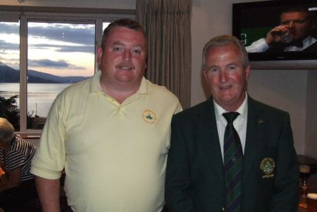 Danny Carr (left), winner of 2008 Captain's Prize in Greenore Golf Club pictured with club captain, Michael Shields, just before the presentation of the prizes on Sunday 31 August 2008.  Carlingford Lough may be seen in the window in the background.